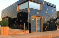 Casa con piel solar