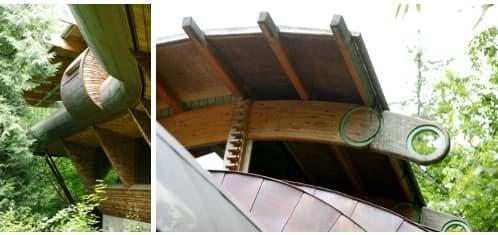 casa con vigas de madera laminada curvada