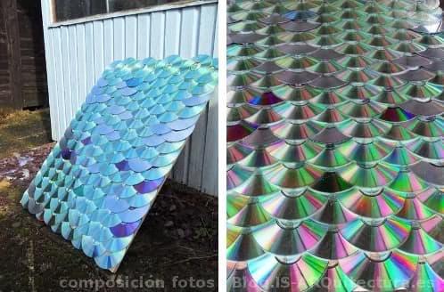 tejado-con-CDs reciclados y clavados en un tablero de madera
