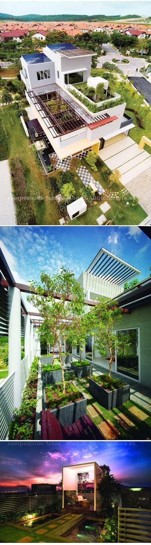 casa con terrazas ajardinadas y estanque de agua