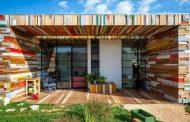 Casa LaHO: reutilizar la madera en la construcción